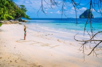 Is Palawan Safe For Tourists To Travel? | Tikigo Tips (Photo of a beach in El Nido with the text HELP drawn in sand)